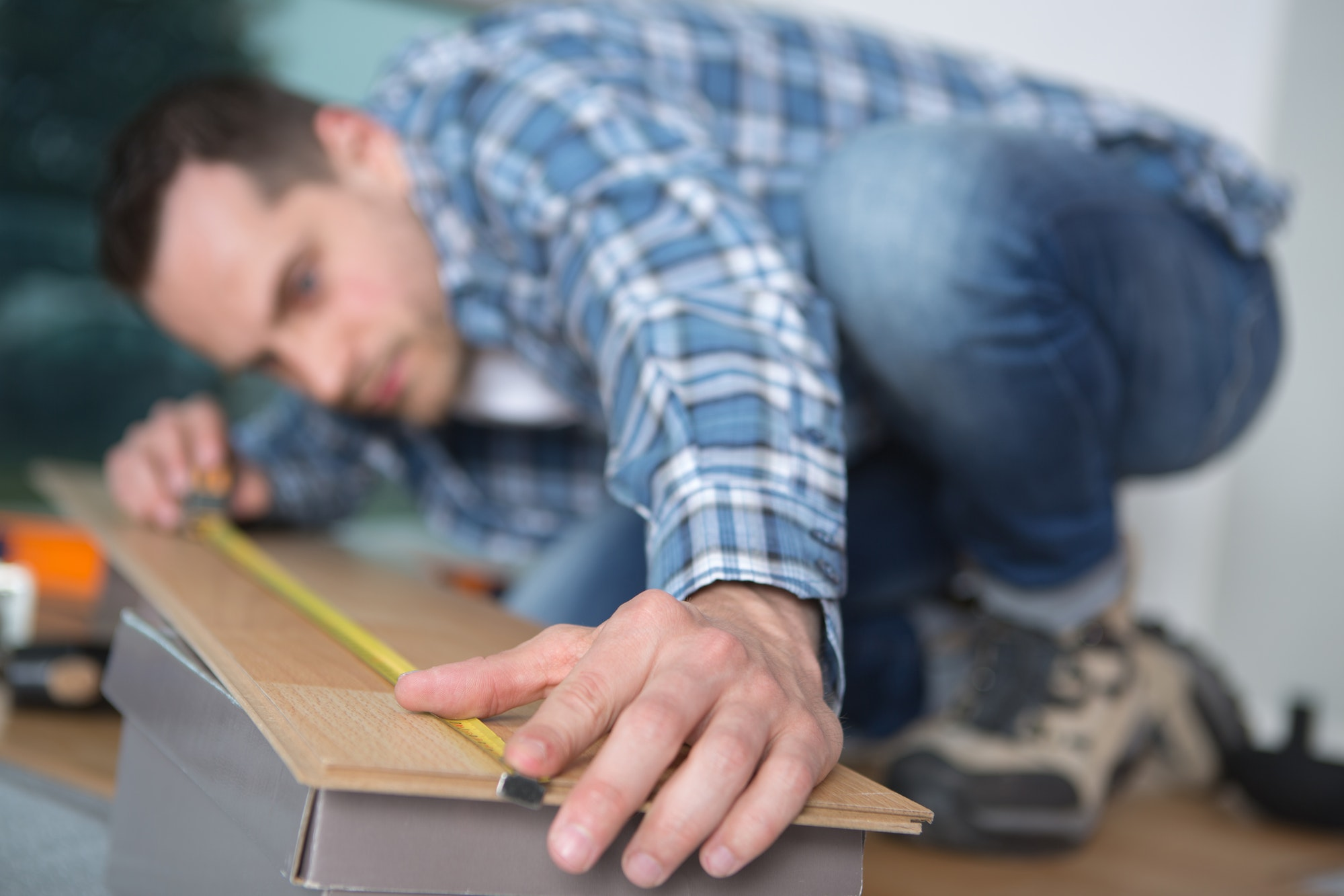 Man measuring laminate board