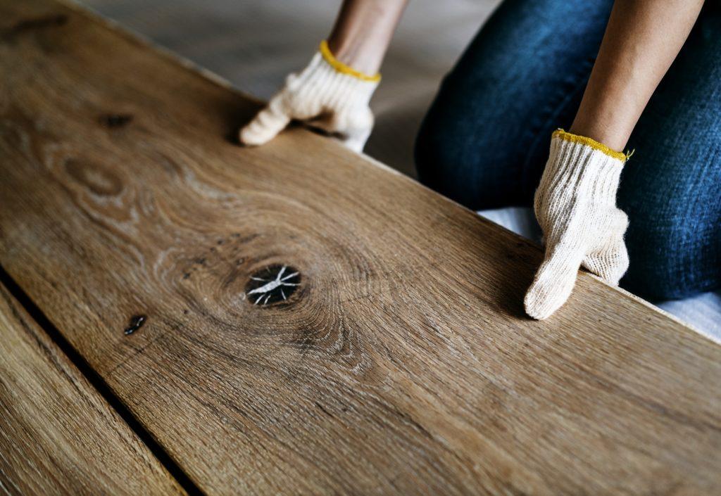 Carpenter man installing wooden floor